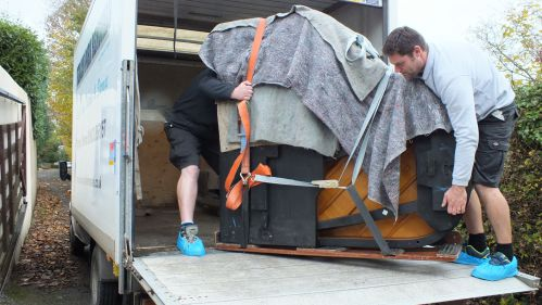 Piano transfered to the vehicle by a hoist