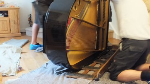 Now on its side the piano is place on a piano shoe