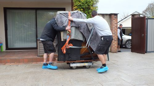 Piano is strapped down for the move